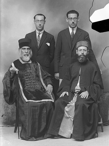 Members of the Romaniote Greek Jewish Community of Volos: Rabbi Moshe Pesach (front left) with his sons (back)