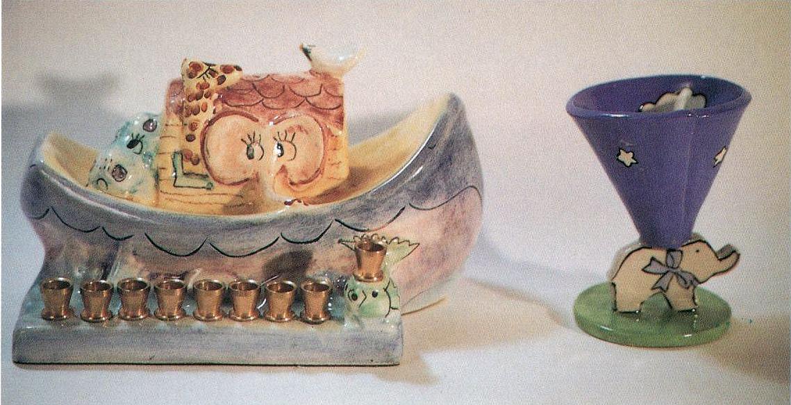 ceramic menorah and baby's cup
