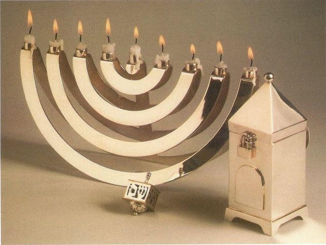 Hanukkah menorah, dreidel and tzedakah box