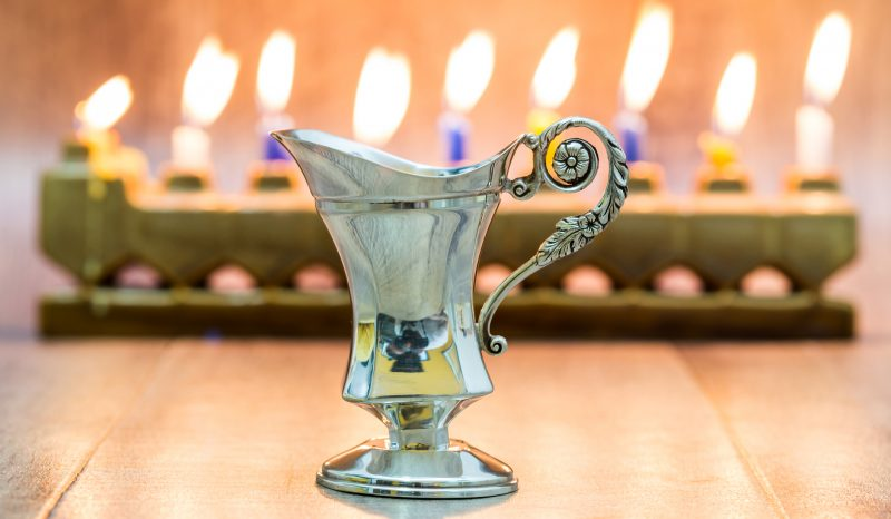 menorah with oil jug