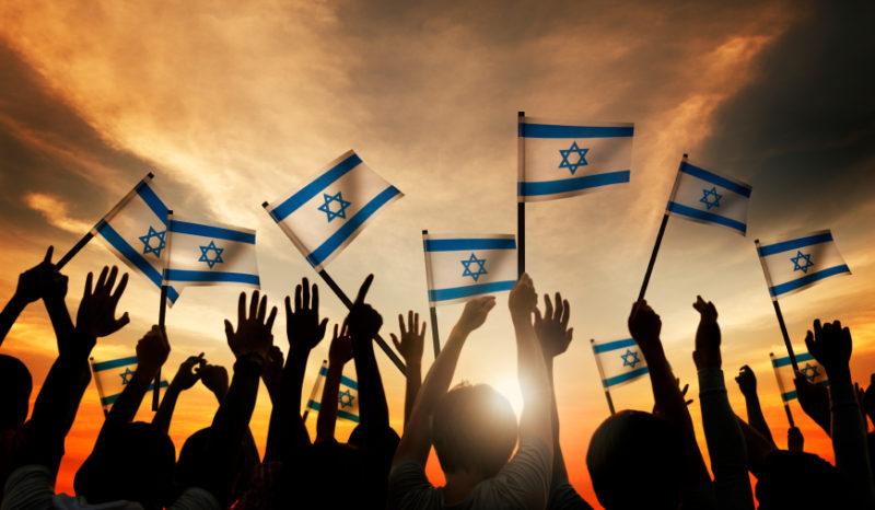 People Holding Israeli Flag